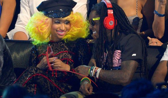 Nicki Minaj, left, and Lil Wayne sit in the audience in the audience at the MTV Video Music Awards on Thursday, Sept. 6, 2012, in Los Angeles. (Photo by Mark J. Terrill/Invision/AP)