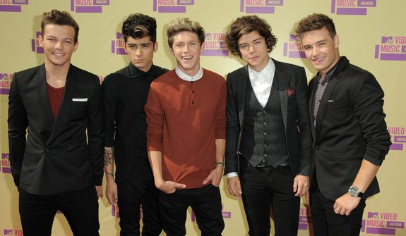 Members of the British band One Direction, from left, Louis Tomlinson, Zayn Malik, Niall Horan, Harry Styles and Liam Payne arrive at the MTV Video Music Awards on Thursday, Sept. 6, 2012, in Los Angeles. (Photo by Jordan Strauss/Invision/AP)