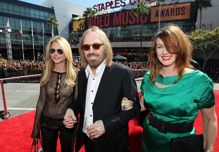 Singer Tom Petty, center, Dana York, right, and Adria Petty arrive at the MTV Video Music Awards on Thursday, Sept. 6, 2012, in Los Angeles. (Photo by Matt Sayles/Invision/AP)
