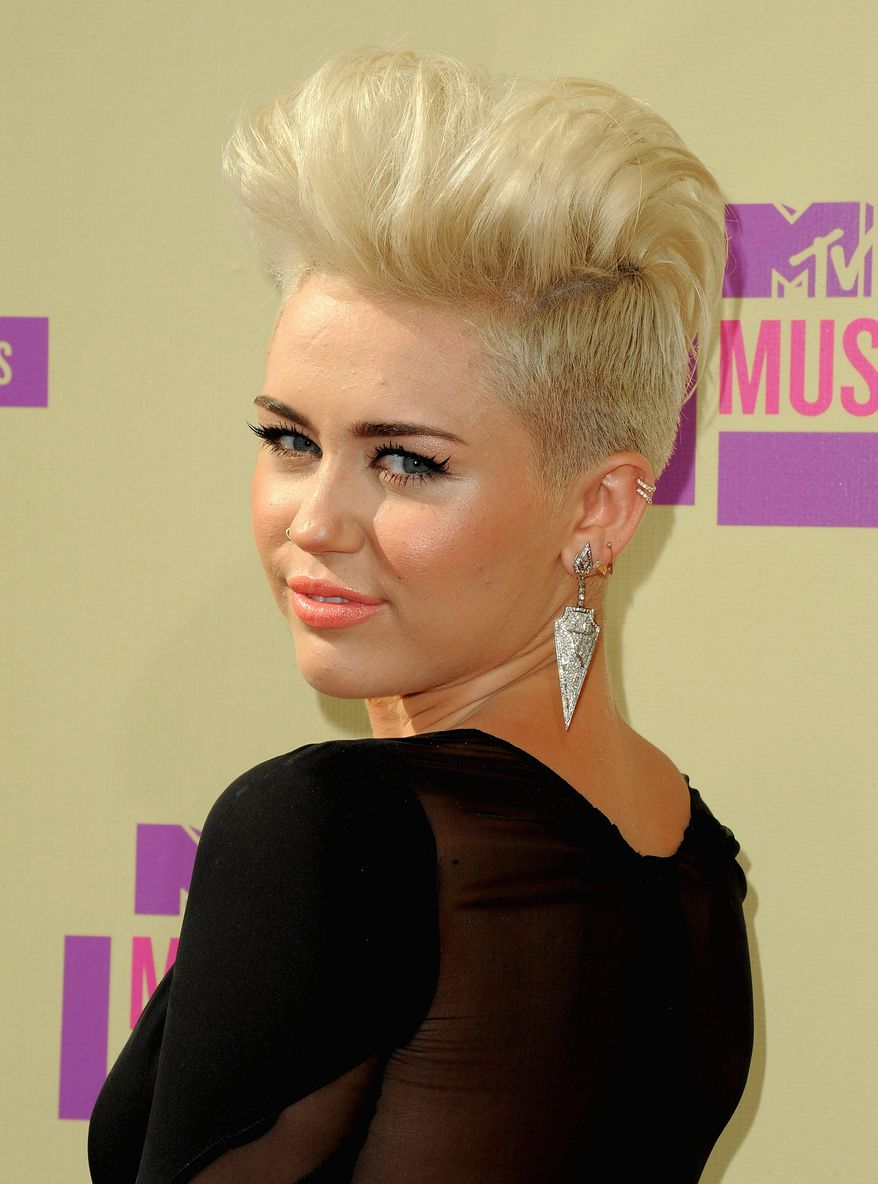 Miley Cyrus attends the MTV Video Music Awards on Thursday, Sept. 6, 2012, in Los Angeles. (Photo by Jordan Strauss/Invision/AP)