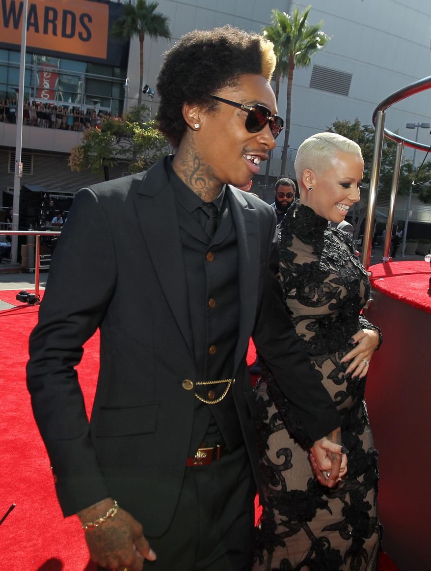Wiz Khalifa, left, and Amber Rose arrive at the MTV Video Music Awards on Thursday, Sept. 6, 2012, in Los Angeles. (Photo by Matt Sayles/Invision/AP)