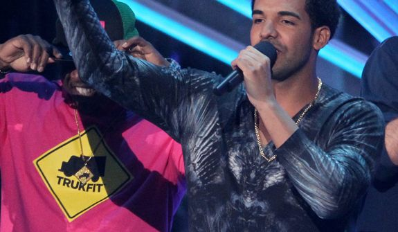 "Drake accepts the award for best hip-hop video for ""Hyfr"" at the MTV Video Music Awards on Thursday, Sept. 6, 2012, in Los Angeles. (Photo by Matt Sayles/Invision/AP)"
