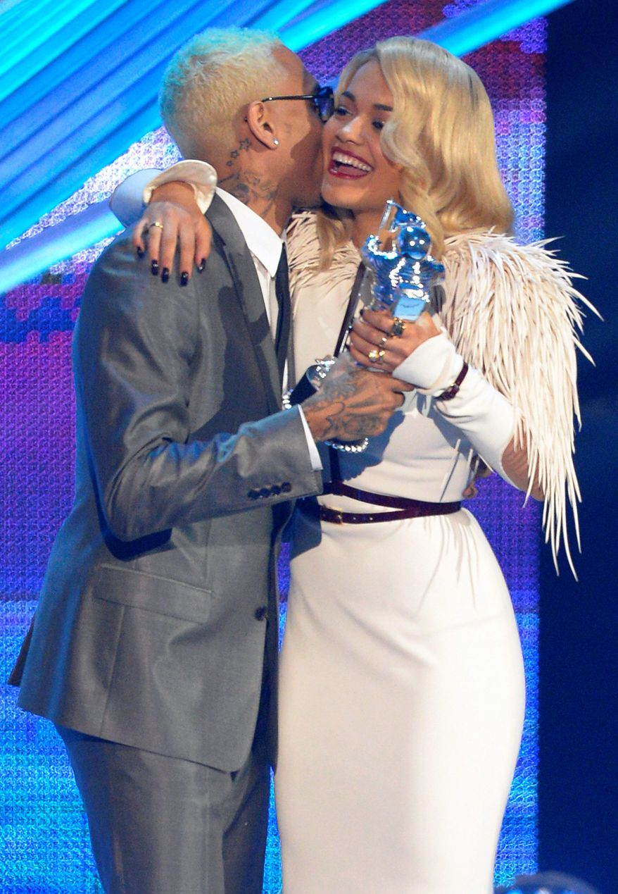 Rita Ora, right, presents the award for best male video to Chris Brown for ìTurn Up the Musicî at the MTV Video Music Awards on Thursday, Sept. 6, 2012, in Los Angeles. (Photo by Mark J. Terrill/Invision/AP)