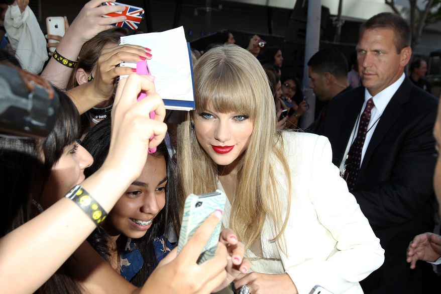 Taylor Swift greets fans at the MTV Video Music Awards on Thursday, Sept. 6, 2012, in Los Angeles. (Photo by Matt Sayles/Invision/AP)