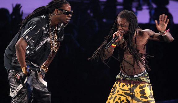 Lil Wayne, right, and 2 Chainz perform onstage at the MTV Video Music Awards on Thursday, Sept. 6, 2012, in Los Angeles. (Photo by Matt Sayles/Invision/AP)