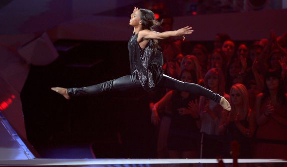 Gabrielle Douglas performs onstage at the MTV Video Music Awards on Thursday, Sept. 6, 2012, in Los Angeles. (Photo by Mark J. Terrill/Invision/AP)