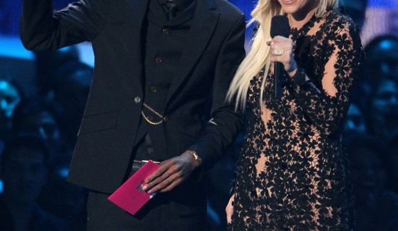 Wiz Khalifa, left, and Ke$ha present an award onstage at the MTV Video Music Awards on Thursday, Sept. 6, 2012, in Los Angeles. (Photo by Matt Sayles/Invision/AP)