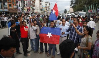 ** FILE ** A small group of Nepal Youth Front, the student organization of Communist Party of Nepal (Unified Marxist-Leninist), hold their flags and shout slogans during a protest against the hike of fuel prices in Katmandu, Nepal, Monday, Sept. 3, 2012. The state-owned Nepal Oil Corp. Sunday announced the rise in prices, which came into effect Monday. (AP Photo/Niranjan Shrestha)