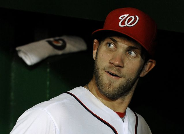 Washington Nationals' Bryce Harper looks back onto the field before heading into the clubhouse after their baseball game against the Chicago Cubs at Nationals Park, Wednesday, Sept. 5, 2012, in Washington. (AP Photo/Richard Lipski)