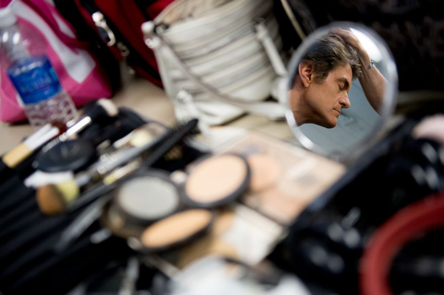Dr. Mehmet Oz, host of The Dr. Oz Show gets hair and make-up done as he hosts a 15-minute clinic open to the public with the help of Howard University medical students to get a very basic idea of people's general risk for heart disease and diabetes at Howard University in the District on Wednesday, Sept. 5, 2012. (Andrew Harnik/The Washington Times)