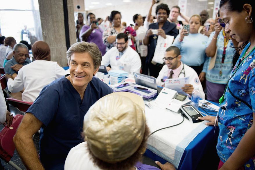 "**FILE** Dr. Mehmet Oz, host of ""The Dr. Oz Show,"" sits down to go through the exam of Gladys Nealy of Washington, D.C., during a 15-minute clinic open to the public with the help of Howard University medical students at the school's campus on Sept. 5, 2012. The clinic was held to get a basic idea of people's general risk for heart disease and diabetes. (Andrew Harnik/The Washington Times)"