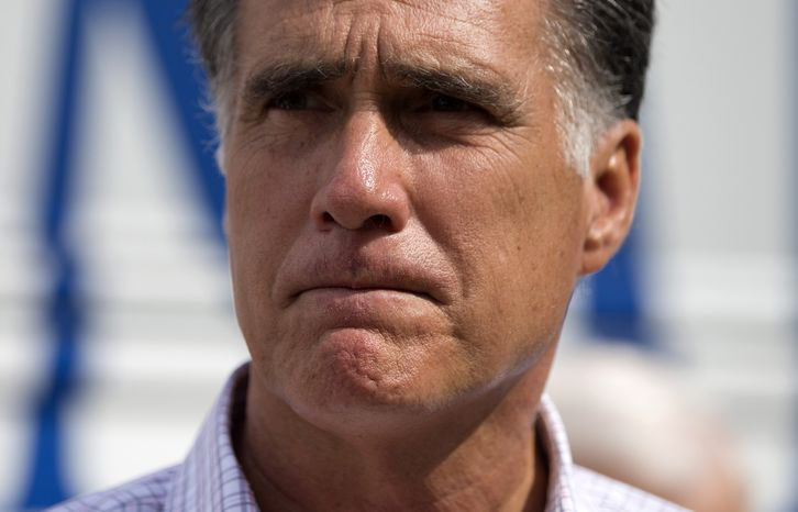 "Republican presidential candidate Mitt Romney speaks Sept. 6, 2012, with reporters after making a stop at the ""New Hampshire Veterans and Military Families for Mitt"" event in Concord, N.H. (Associated Press)"