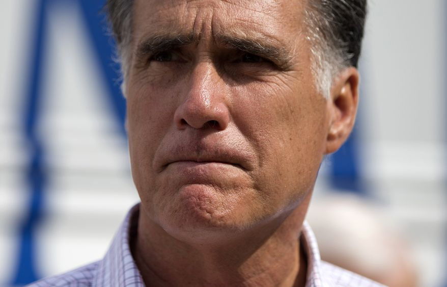 """Republican presidential candidate Mitt Romney speaks Sept. 6, 2012, with reporters after making a stop at the """"New Hampshire Veterans and Military Families for Mitt"""" event in Concord, N.H. (Associated Press)"""