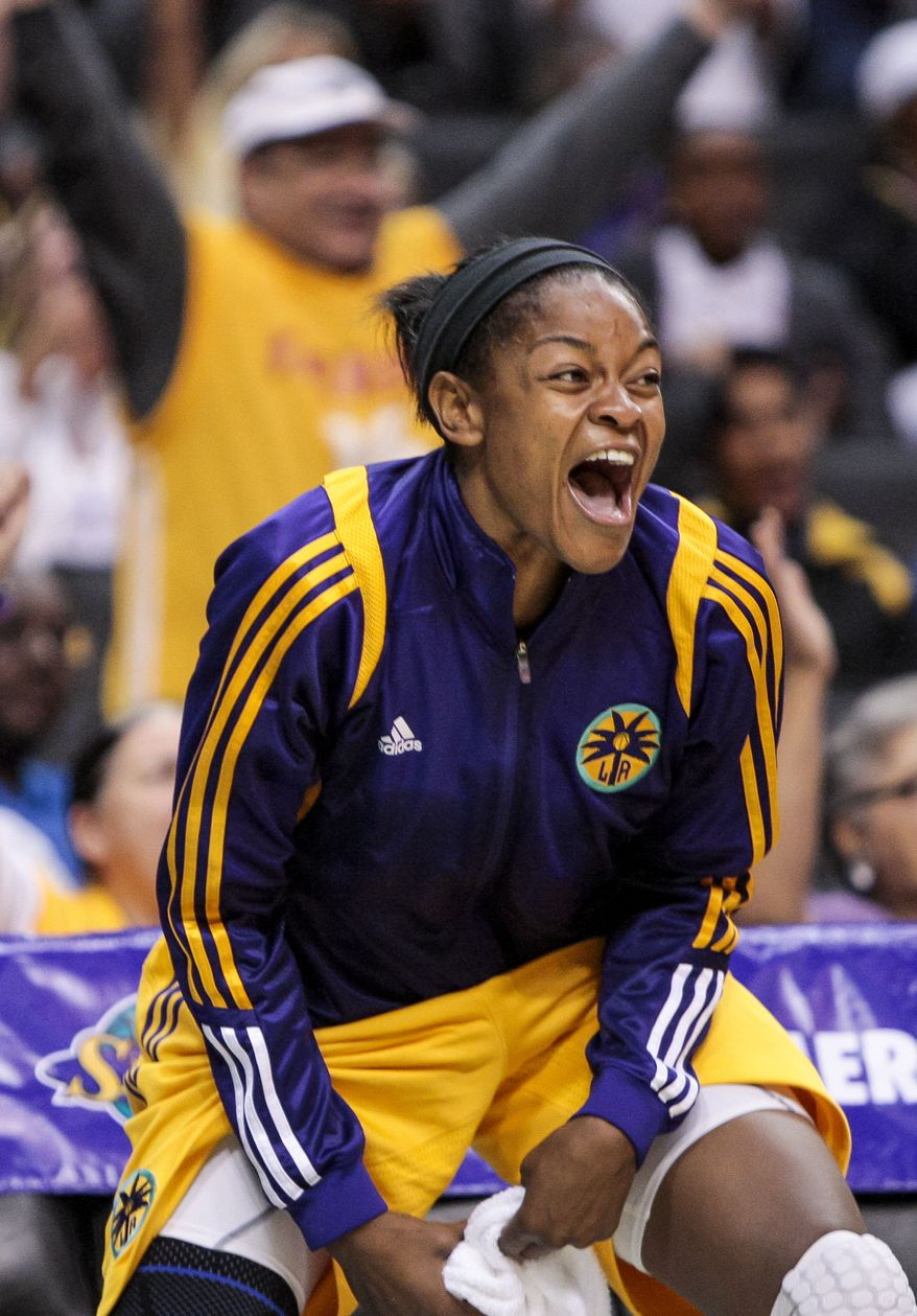 Los Angeles Sparks forward Alana Beard cheers from the bench after sparks went over 100 points during the second half of a WNBA basketball game San Antonio Silver Stars, Thursday, Aug. 23, 2012, in Los Angeles. The Sparks won 101-77. (AP Photo/Bret Hartman)