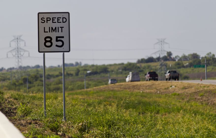An 85 mph speed limit sign is placed Sept. 6, 2012, on a 41-mile toll road in Austin, Texas, near the increasingly crowded Interstate between Austin and San Antonio. (Associated Press/Statesman.com, Ricardo B. Brazziell)