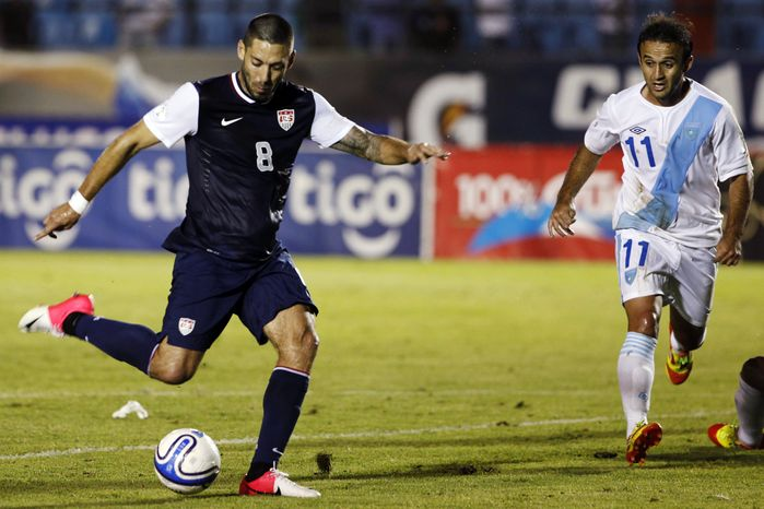 FILE - In this June 12, 2012, file photo, United States' Clint Dempsey, left, scores against Guatemala during a 2014 World Cup qualifying soccer match in Guatemala City. Dempsey hasn't played in a competitive game since June, a streak he hopes to see end on Friday, Sept. 7, when the Americans head to Jamaica for the start of a home-and-home World Cup qualifying series that could go a long way toward which nation gets to take control of Group A. (AP Photo/Moises Castillo, File)