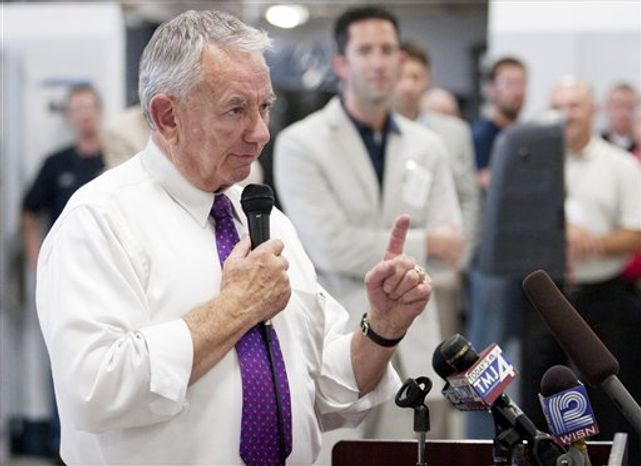 Former Wisconsin Gov. Tommy Thompson, the Republican candidate for the U.S. Senate, speaks on Wednesday, Aug. 15, 2012, to HUSCO International Inc. employees during a campaign appearance at the company's Waukesha, Wis., facility. Mr. Thompson will face Democratic Rep. Tammy Baldwin in the November election. (AP Photo/The Waukesha Freeman)