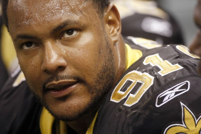Saints defensive end Will Smith (shown) and linebacker Jonathan Vilma are eligible to play versus the Redskins on Sunday after an appeals panel overturned the suspensions for the players involved in the bounty scandal. (AP Photo/Dave Martin, File)