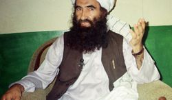 **FILE** Jalaluddin Haqqani, founder of the militant group the Haqqani network, speaks Aug. 22, 1998, during an interview in Miram Shah, Pakistan. (Associated Press)