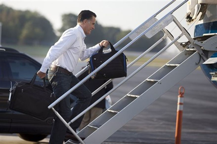 Republican presidential candidate, former Massachusetts Gov. Mitt Romney boards his campaign plane for an event in Iowa on Friday, Sept. 7, 2012, in Portsmouth, N.H. (AP Photo/Evan Vucci)