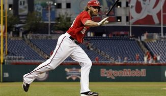 Washington Nationals' Jayson Werth tosses his bat after the hit for his solo home run to tie the game during the ninth inning of a baseball game against the Miami Marlins at Nationals Park Saturday, Sept. 8, 2012, in Washington. The Nationals won 7-6 in 10 innings. (AP Photo/Alex Brandon)