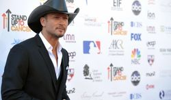 """Musician Tim McGraw attends the """"Stand Up to Cancer"""" event at the Shrine Auditorium on Friday, Sept. 7, 2012, in Los Angeles. The initiative aimed to raise funds to accelerate innovative cancer research by bringing new therapies to patients quickly. (Photo by John Shearer/Invision/AP)"""