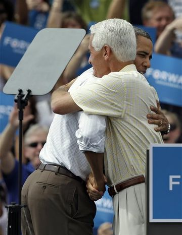 President Obama, background, gets a hug from Charlie Crist after being introduced by the former Florida governor during a campaign rally Saturday, Sept. 8, 2012, in Seminole, Fla. (AP Photo/Chris O'Meara)