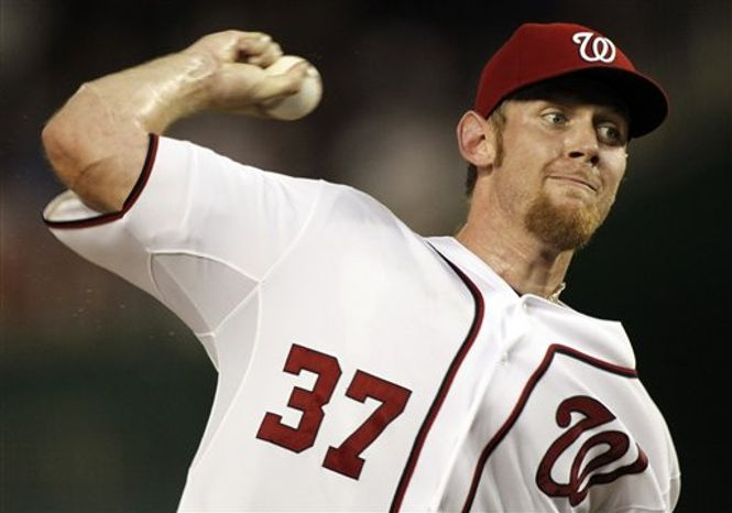 Washington Nationals starting pitcher Stephen Strasburg throws during the second inning of a baseball game against the Miami Marlins at Nationals Park, Friday, Sept. 7, 2012, in Washington. (AP Photo/Alex Brandon)