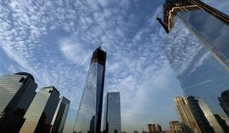 One World Trade Center, center, rises above the National September 11 Memorial and Museum at the World Trade Center, Thursday, Sept. 6, 2012, in New York. Tuesday will mark the 11th anniversary of the terrorist attacks of Sept. 11, 2001. The World Financial Center is on the left, and Four World Trade Center is at right. (AP Photo/Mark Lennihan)