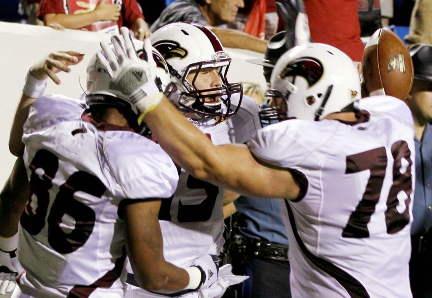 associated press Louisiana Monroe quarterback Kolton Browning (center) celebrates with teammates after rallying the Warhawks from a 28-7 deficit to a 34-31 overtime victory over Arkansas. Next up for the Razorbacks is a visit from SEC power Alabama.