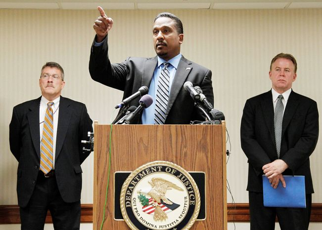 U.S. Attorney for the District Ronald C. Machen Jr. holds a news briefing in July with Ronald T. Hosko of the FBI (left) and Rick A. Raven of the Internal Revenue Service about the guilty plea of Eugenia C. Harris for city political campaign violations. (Associated Press)