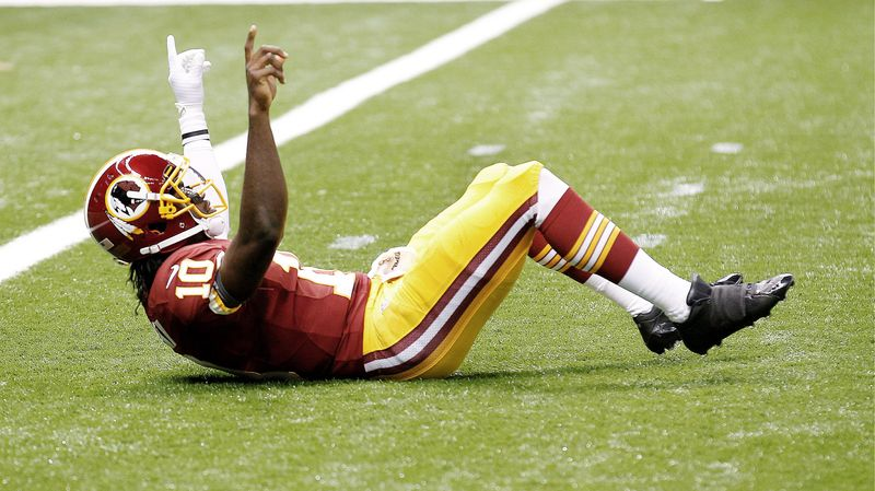 Redskins rookie quarterback Robert Griffin III celebrates after taking a shot from New Orleans safety Malcolm Jenkins on an 88-yard touchdown pass to wide receiver Pierre Garcon. The TD came on the first play from scrimmage after the Saints had taken a 7-3 lead. (Associated Press)