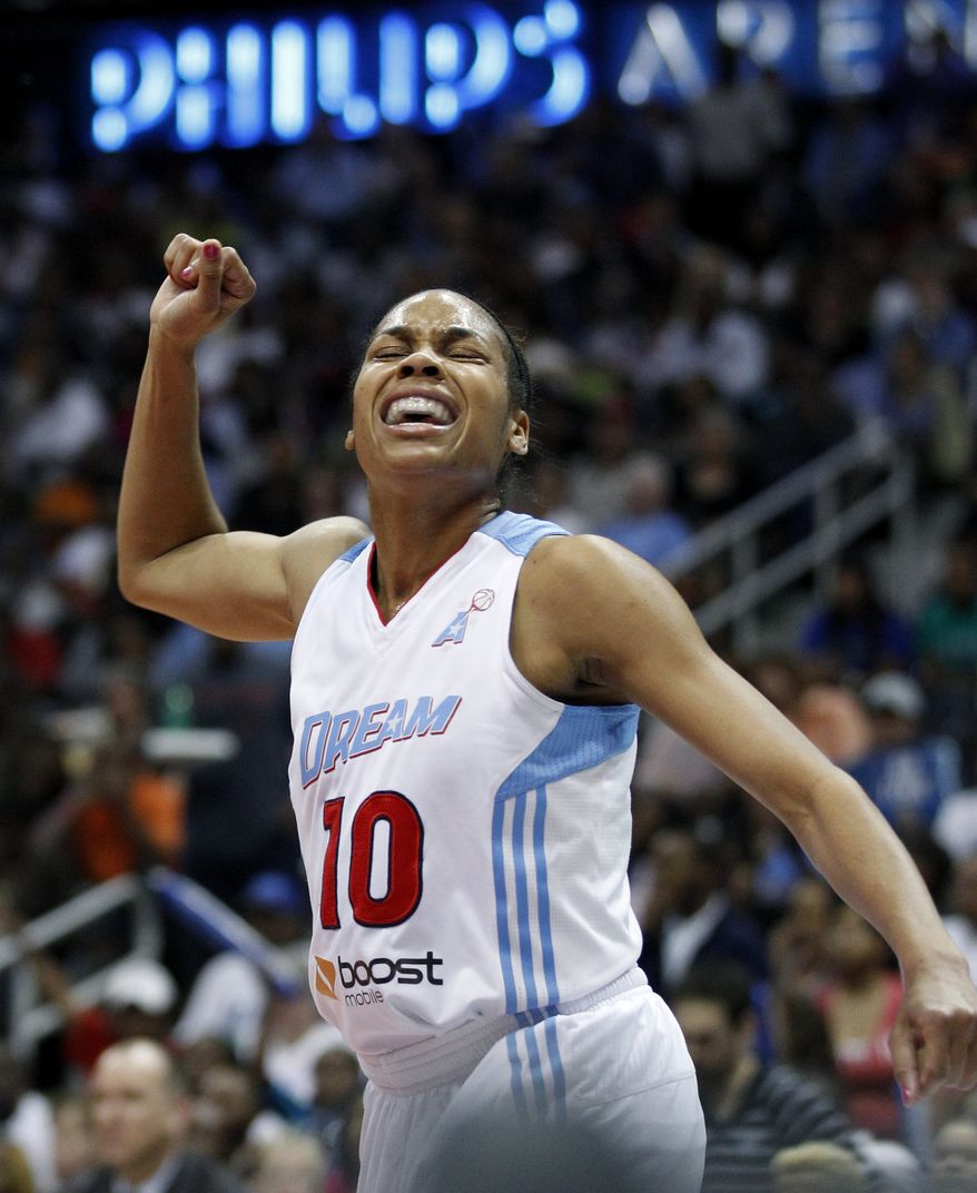 FILE - Atlanta Dream guard Lindsey Harding reacts after a loose ball foul is called on the Minnesota Lynx during the first quarter of Game 3 of the WNBA basketball finals in this Oct. 7, 2011 file photo taken in Atlanta. Harding took a break from basketball this past winter and spent the WNBA offseason doing some running. The Atlanta Dream guard trained for some long-distance runs and competed in three half-marathons inFeb. and March 2012.  (AP Photo/David Goldman)