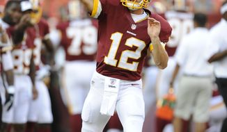 Washington Redskins quarterback Kirk Cousins (12) warms up before an NFL preseason football game against the Tampa Bay Buccaneers, Wednesday, Aug. 29, 2012, in Landover, Md. (AP Photo/Nick Wass)