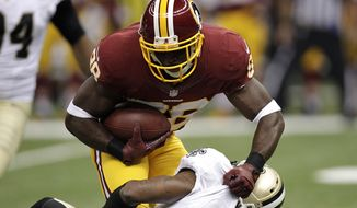 Washington Redskins wide receiver Pierre Garcon (88) is tackled by New Orleans Saints strong safety Corey White (24) in the first half of an NFL football game at the Mercedes-Benz Superdome in New Orleans, Sunday, Sept. 9, 2012. (AP Photo/Gerald Herbert)