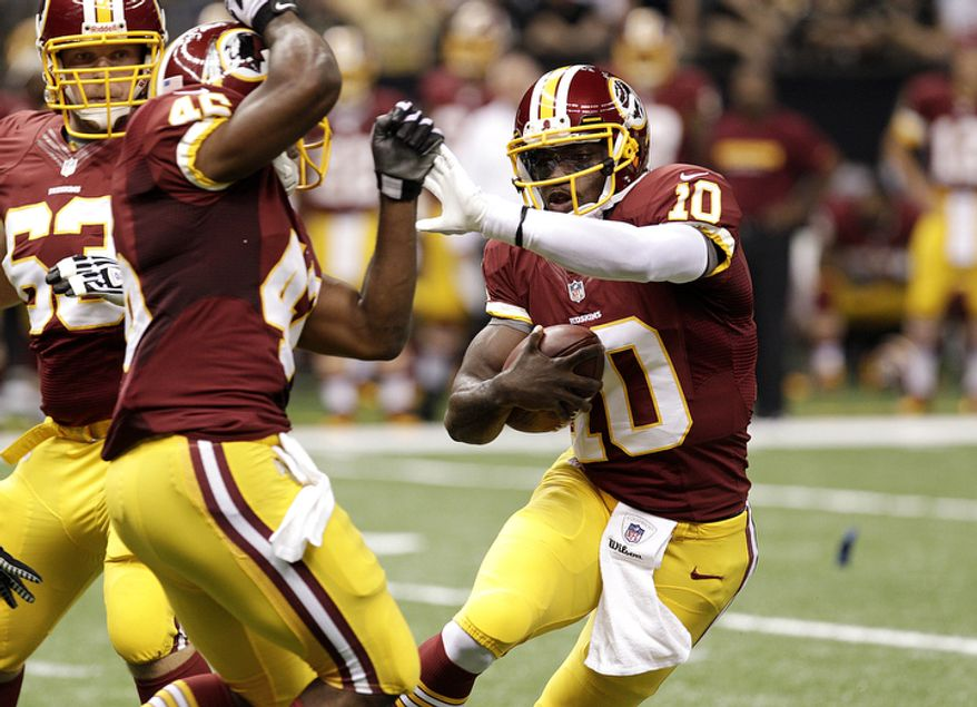 Washington Redskins quarterback Robert Griffin III (10) rushes in the first half of an NFL football game against the New Orleans Saints at the Mercedes-Benz Superdome in New Orleans, Sunday, Sept. 9, 2012. (AP Photo/Matthew Hinton)