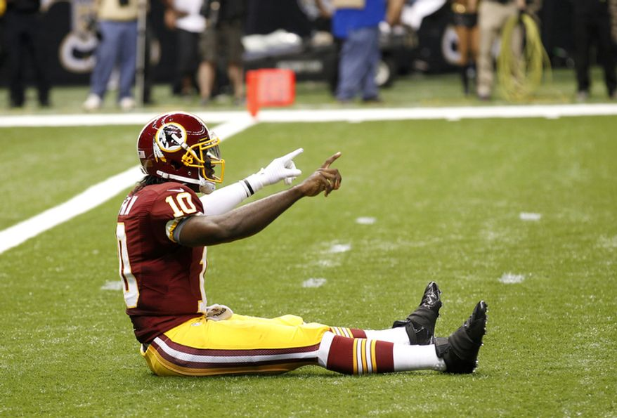 Washington Redskins quarterback Robert Griffin III (10) reacts after throwing a touchdown pass in the first quarter of an NFL football game against the New Orleans Saints at the Mercedes-Benz Superdome in New Orleans, Sunday, Sept. 9, 2012. (AP Photo/Bill Haber)
