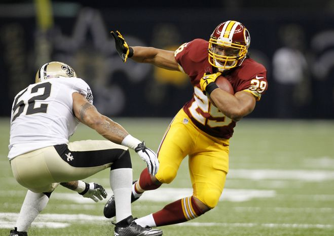 Washington Redskins running back Roy Helu (29) rushes past New Orleans Saints linebacker Jonathan Casillas (52) in the first half of an NFL football game at the Mercedes-Benz Superdome in New Orleans, Sunday, Sept. 9, 2012. (AP Photo/Gerald H