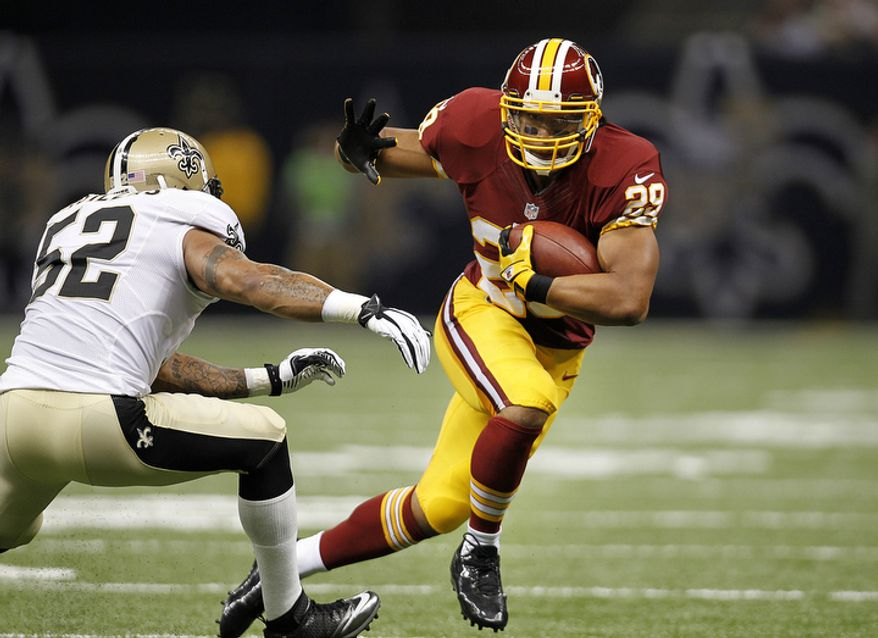 Washington Redskins running back Roy Helu (29) carries past New Orleans Saints linebacker Jonathan Casillas (52) in the first half of an NFL football game at the Mercedes-Benz Superdome in New Orleans, Sunday, Sept. 9, 2012. (AP Photo/Gerald Herbert)