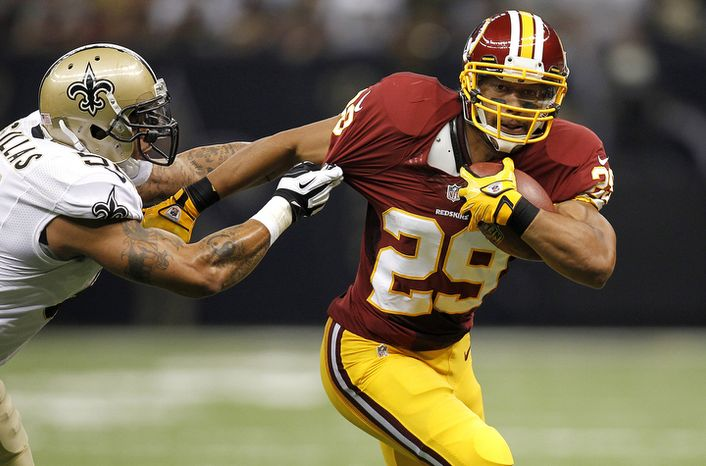Washington Redskins running back Roy Helu (29) tries to elude New Orleans Saints linebacker Jonathan Casillas (52) in the first half of an NFL football game at Mercedes-Benz Superdome in New Orleans, Sunday, Sept. 9, 2012. (AP Photo/Gerald Herbert)