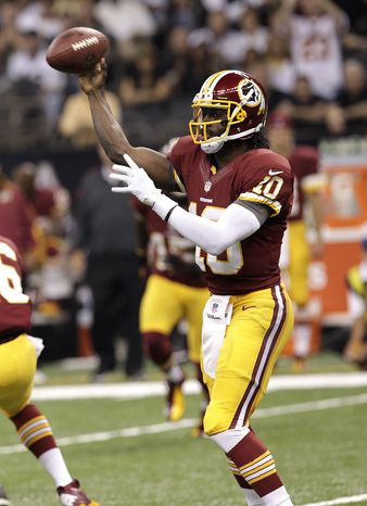 Washington Redskins quarterback Robert Griffin III (10) passes in the first half of an NFL football game against the New Orleans Saints at Mercedes-Benz Superdome in New Orleans, Sunday, Sept. 9, 2012. (AP Photo/M