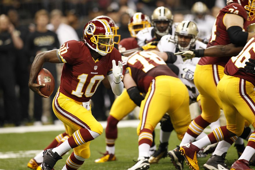 Washington Redskins quarterback Robert Griffin III (10) rushes in the first half of an NFL football game against the New Orleans Saints at the Mercedes-Benz Superdome in New Orleans, Sunday, Sept. 9, 2012. (AP Photo/Bill Haber)