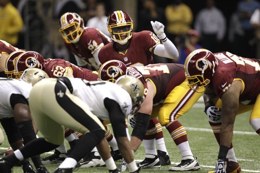 Washington Redskins quarterback Robert Griffin III (10) calls a play in the second half of an NFL football game against the New Orleans Saints at the Mercedes-Benz Superdome in New Orleans, Sunday, Sept. 9, 2012. (AP Photo/Matthew Hinton)