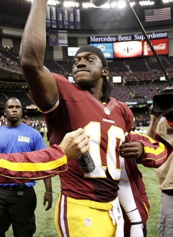 Washington Redskins quarterback Robert Griffin III (10) reacts to the crowd after an NFL football game against the New Orleans Saints at Mercedes-Benz Superdome in New Orleans, Sunday, Sept. 9, 2