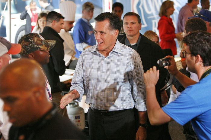 Republican presidential candidate Mitt Romney (center) greets a supporter as he arrives at the Richmond International Raceway on Saturday, Sept. 8, 2012, in Richmond. (AP Photo/Richmond Times-Dispatch, Dean Hoffmeyer)