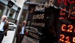 A sign in Buenos Aires shows the exchange rate last week for the Argentine peso, which is declining rapidly. It has lost nearly 8 percent of its value against the dollar this year, more than in all of last year.