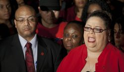 Chicago Teachers Union President Karen Lewis (right) tells reporters at a news conference outside the union's headquarters that the city's 25,000 public school teachers will walk the picket line Monday morning after final-day talks with the Chicago Board of Education failed to reach an agreement over teachers' contracts on Sunday, Sept. 9, 2012, in Chicago. (AP Photo/Sitthixay Ditthavong)