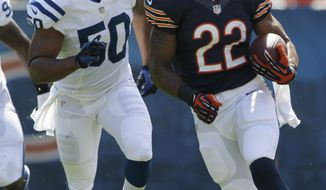 Chicago Bears running back Matt Forte (22) rushes for 32 yards with Indianapolis Colts linebacker Jerrell Freeman (50) pursuing during the first half of an NFL football game in Chicago, Sunday, Sept. 9, 2012. (AP Photo/Nam Y. Huh)