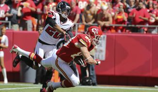 Kansas City Chiefs tight end Kevin Boss (80) catches a touchdown pass while covered by Atlanta Falcons cornerback Brent Grimes (20) during the first half of an NFL football game at Arrowhead Stadium in Kansas City, Mo., Sunday, Sept. 9, 2012. (AP Photo/Ed Zurga)