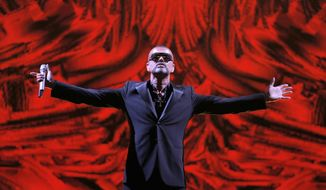 **FILE** British singer George Michael performs in concert to raise money for the AIDS charity Sidaction at the Paris Opera's Palais Garnier in Paris on Sept. 9, 2012. (Associated Press)